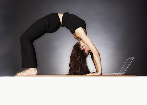 Woman doing yoga while using laptop