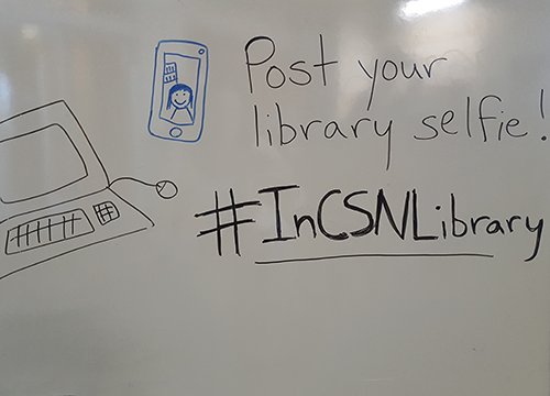 whiteboard with hashtag #inCSNLibrary